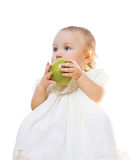 Little girl with an apple. Little girl with a granny smith apple Stock Photo