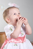 Little girl is an apple. Royalty Free Stock Photography