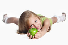 Little girl with an apple Stock Photography