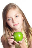 Little girl with an apple. Little blond girl with holding a green apple isolated on white Royalty Free Stock Images