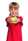 Little girl with apple Stock Photos