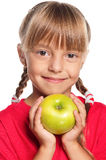 Little girl with apple Stock Photo