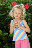 Little girl with an apple Stock Images
