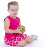 Little girl with apple Royalty Free Stock Image