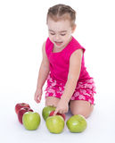 Little girl with apple Stock Photos