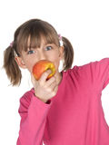 Little girl with apple Stock Photography