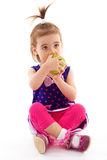 Little girl with apple. Stock Photography
