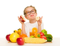 Little girl with apple, fruits and vegetable Royalty Free Stock Images
