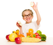 Little girl with apple, fruits and vegetables Stock Photography