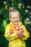 Little girl in the apple garden Stock Photography