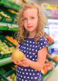 Little girl with apple. Royalty Free Stock Photos