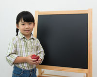 Little girl with apple in hand Stock Photo