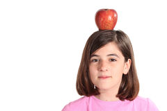 Little girl with an apple on the head. White background Stock Images