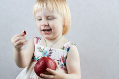 Little girl  with an  apple Royalty Free Stock Photos