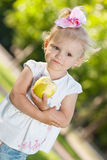 Little girl with an apple in the park Royalty Free Stock Photography