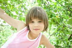 Little girl and apple-tree Stock Images