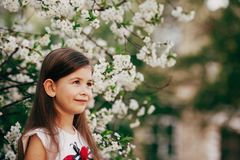 Little girl at apple tree flowers Stock Photography