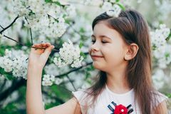 Little girl at apple tree flowers Royalty Free Stock Photo