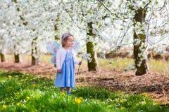 Little girl in apple tree garden Royalty Free Stock Photos