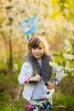 The little girl in an apple-tree garden Stock Photo