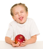 Little girl with apple. On a white Royalty Free Stock Photos