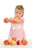The little girl with the apples Stock Images