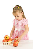 The little girl with the apples. Stock Images