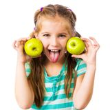 Little girl with apples Stock Photography