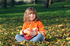 Little girl with apples Stock Photos