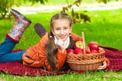 Little girl with apples in  park Stock Photo