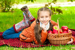 Little girl with apples in  park Stock Images