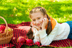 Little girl with apples in  park Royalty Free Stock Photo