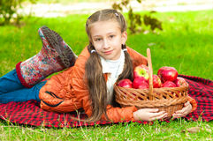 Little girl with apples in  park Royalty Free Stock Image