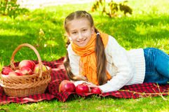 Little girl with apples in  park Royalty Free Stock Photography