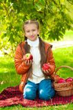 Little girl with apples in  park Stock Photography