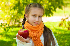 Little girl with apples in  park Stock Image