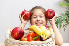 Little girl with apples Royalty Free Stock Photography