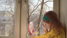 Little girl apply makeup for carnival on her face. stock video