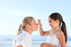 Little girl applying sun cream Stock Photography