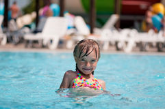 Little girl at aqua park Stock Photos