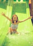 Little girl in aquapark. Royalty Free Stock Photos