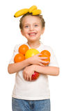 Little girl with armful fruits Stock Photography