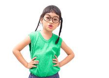 Little girl arms akimbo. Little asian girl with arms akimbo isolated on white background Royalty Free Stock Photos