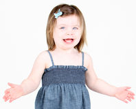 Little girl with arms up on white background Stock Photo