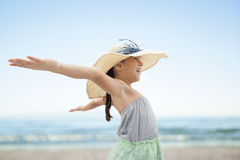 Little girl with arms wide open at beach Royalty Free Stock Photos