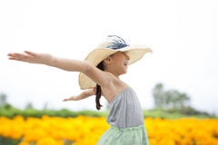 Little girl with arms wide open on nature Stock Photos