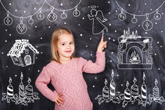 Little girl around the black chalkboards Royalty Free Stock Photos
