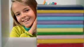 Little girl arranging books on bookshelf stock footage