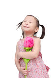 Little girl with artificial rose flower Royalty Free Stock Images