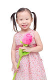 Little girl with artificial rose flower Stock Images